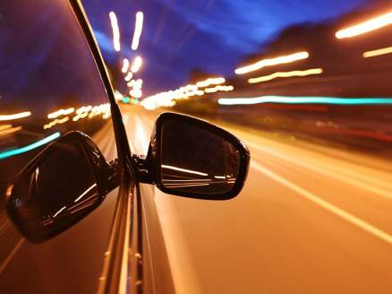 driving-at-night-shutterstock_545359150-768